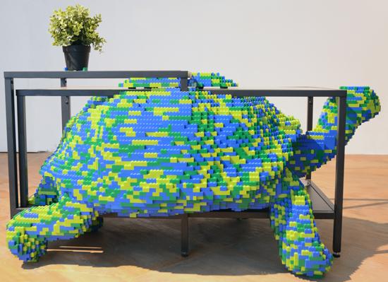 Habitat, tortoise Upstairs Living Room – Tortoise, 2014. Lego, Ikea coffee table and plant