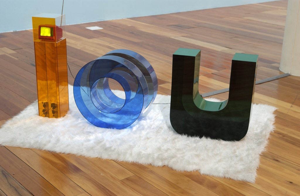 IOU, coloured acrylic sheeting, synthetic rug, television 800 x 2000 x 1500 mm
