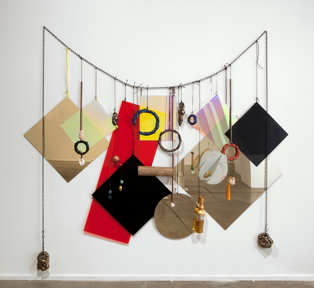Wall Necklace, 2013 perspex, nylon, metal, wood, ceramic, glass, whiskey, 230 x 210cm Courtesy- Roslyn Oxley9 Gallery